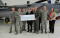 Peter West, director of energy programs for Energy Trust, presented an incentive check to the Oregon Air National Guard for work with Energy Trust for implementing energy-efficient lighting projects throughout the base.