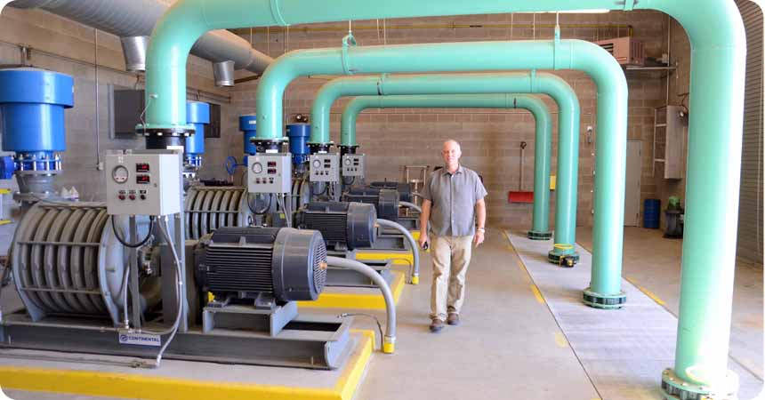 General Manager, Michael T. Fritschi walks through a pump house at the Klamath Falls wastewater treatment plant.