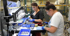 two women working on leatherman tools