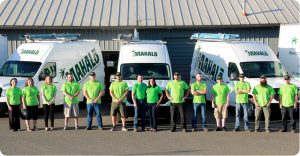 a group of Maholo employees lined up wearing matching shirts