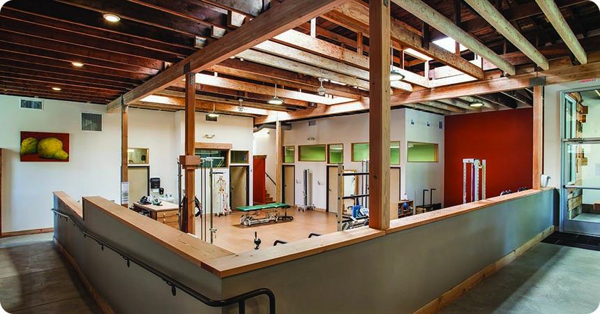 A Work Out Facility With A Skylight Letting In Natural Light