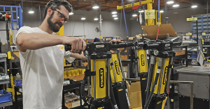 man with safety glasses inspects a stanley product