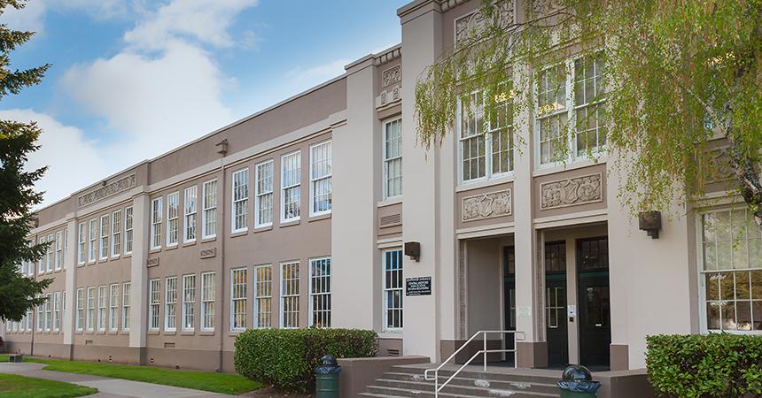 exterior view of a tan school building