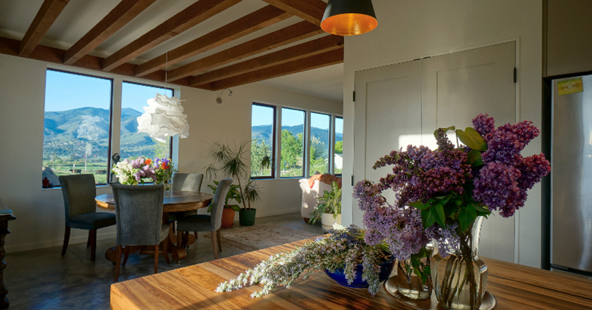a beautiful home interior with a vase of flowers on a wooden table