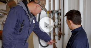 two contractors upgrading a compressed air system