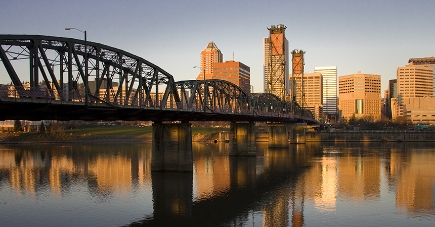 a view of the Hawthorne Bridge in Portland at sunset