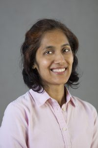 woman smiling. Shilpa Surana of Brightworks Sustainability