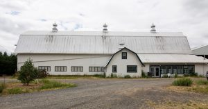 exterior of an old white barn