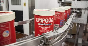 umpqua ice cream carton on a conveyor belt