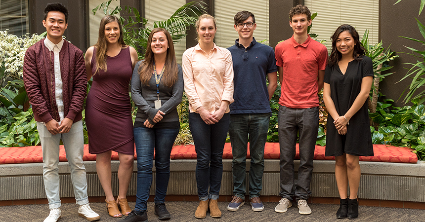 seven of the Energy Trust interns in front of foliage