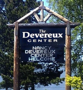 a wooden sign for The Devereux Center