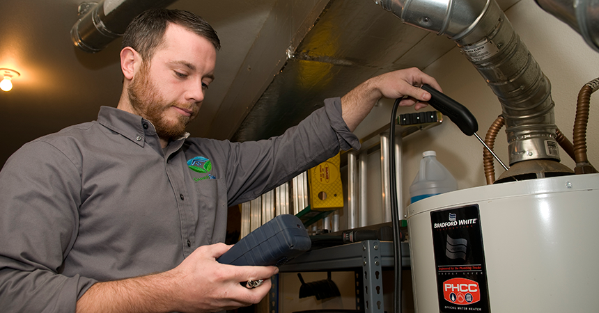 GreenSavers technician performing a test on a water heater