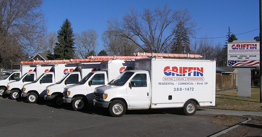 Griffin Heating trucks lined up in front of Griffin Heating.