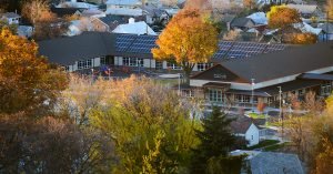 aerial view of a school with fall foliage