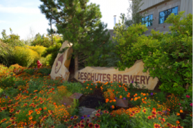 Deschutes Brewery sign with flowers