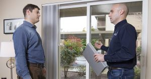 an energy trust representative helping a apartment owner