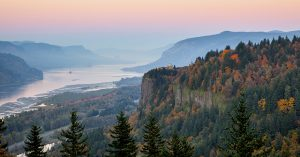 beautiful sunset overlooking a river and fall foliage. The Columbia gorge