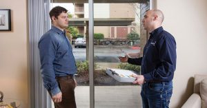 a man talking to an energy trust representative