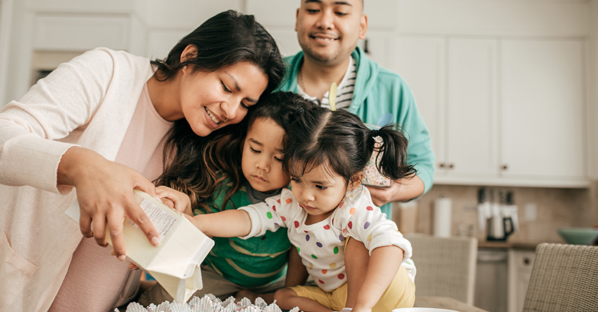 Family of four baking together