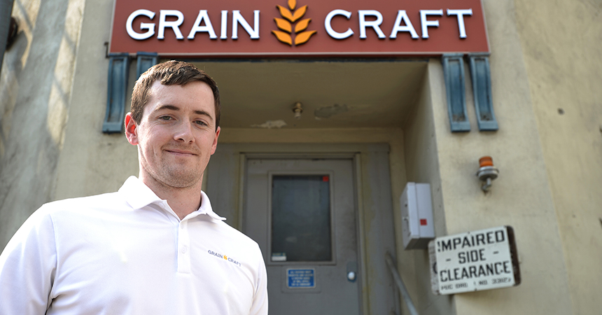 A man standing outside the Grain Craft building