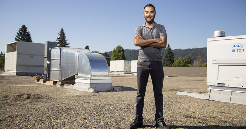 Ankur Rungta, CEO of Cloud Cover Cannabis, stands among rooftop HVAC units installed to maximize the efficiency of the firm's indoor cannabis growing facility.