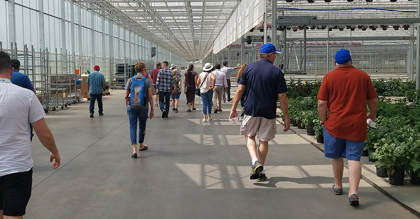 People walking though the green house at smith gardens