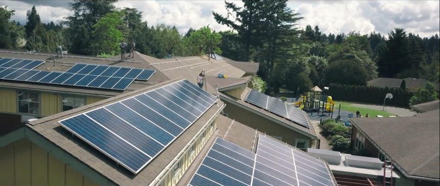 a collection of buildings with solar panels on their roofs