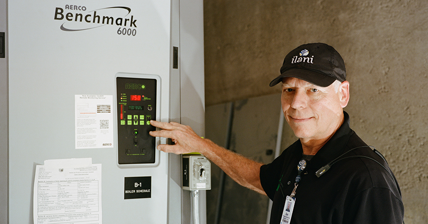 Dan Lincoln, building employee, ilani Casino Resort, demonstrates the control panel on a High-Efficiency Condensing Boiler.