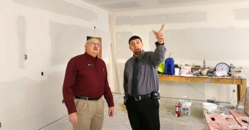 Mike Cleveland and Tyler Phelps check out progress of construction for EOCI's new wellness and training center for employees.