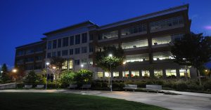 an office building at night with pleasant lighting