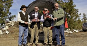 4 men smiling in front of a large irrigation pipeLeft to right: Ron Cochran, chair, Tumalo Irrigation District; Matthew Lohr, director, Natural Resources Conservation Service; Ken Rieck, manager, Tumalo Irrigation District; Jeff Merkley, United States Senator.