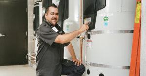 a technician inspecting an energy efficient water heater