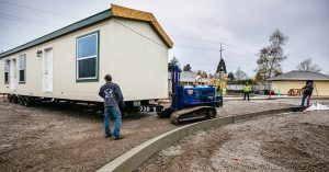 New, energy efficient manufactured homes delivered to Oak Leaf park in Cully