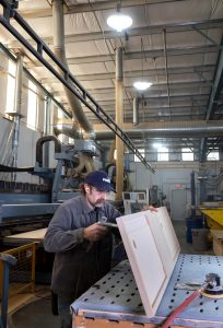 A man working with tools in a warehouse