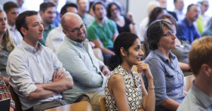 Attendees at a conference listening to a speaker.