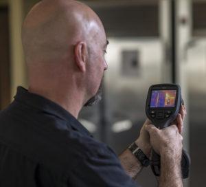 a man looking at a heat signal tool