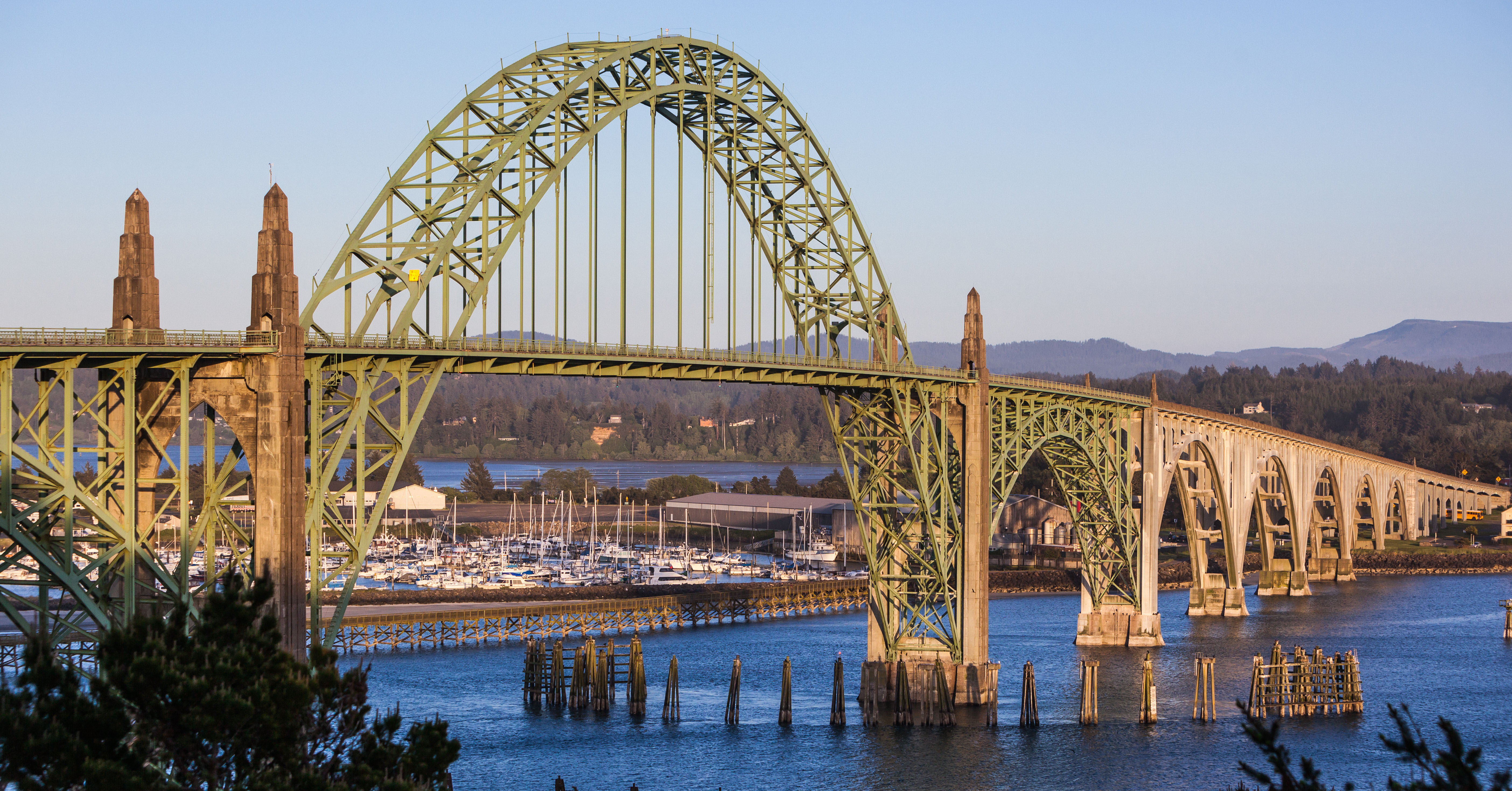 a bridge in newport oregon at sunset