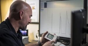 a man examining a diagnostic tool
