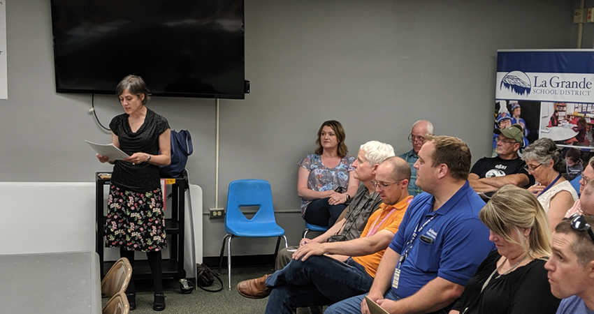 Energy Trust's Eastern Oregon outreach manager, Caryn Appler, shared La Grande School District's energy-efficiency report card with community members during a school board meeting in June.