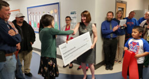 Umatilla School District's superintendent, Heidi Sipe, accepts a check from Energy Trust.