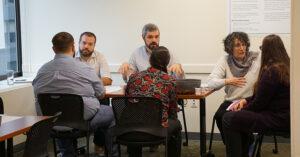 Energy Trust employees explaining the budget