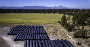 irrigation pipes with mountains in the background