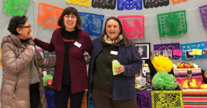 energy trust outreach staff at a day of the dead event