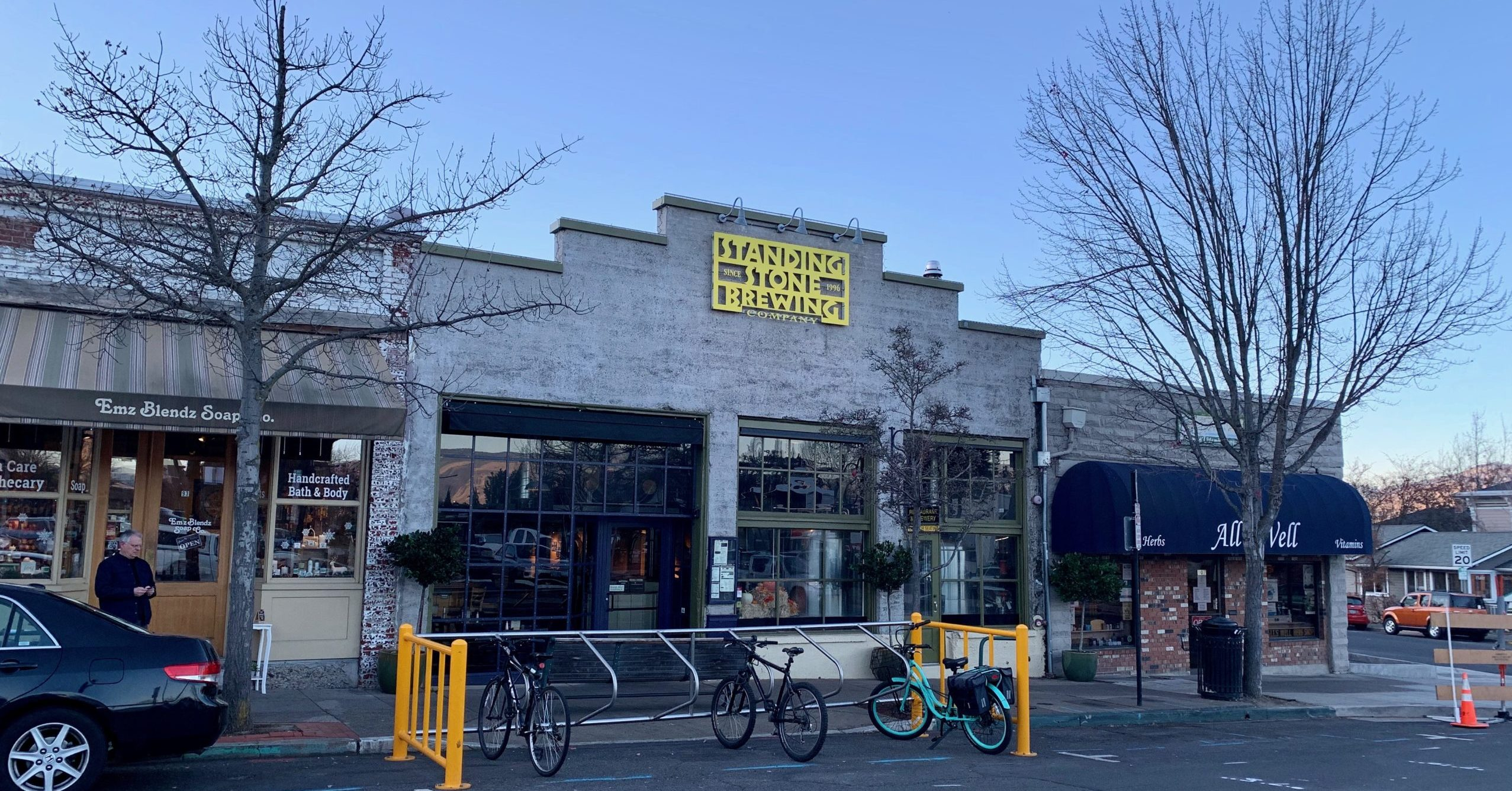 A brewery storefront with bike parking