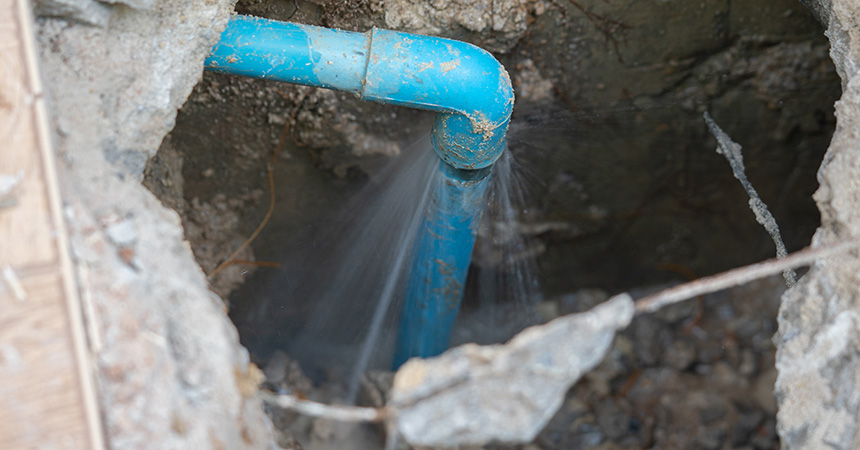 leaking water from blue pipe from underground