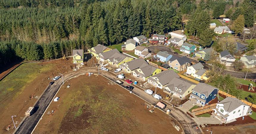 Aerial shot of houses in neighborhood.