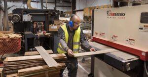 a man cutting lumber