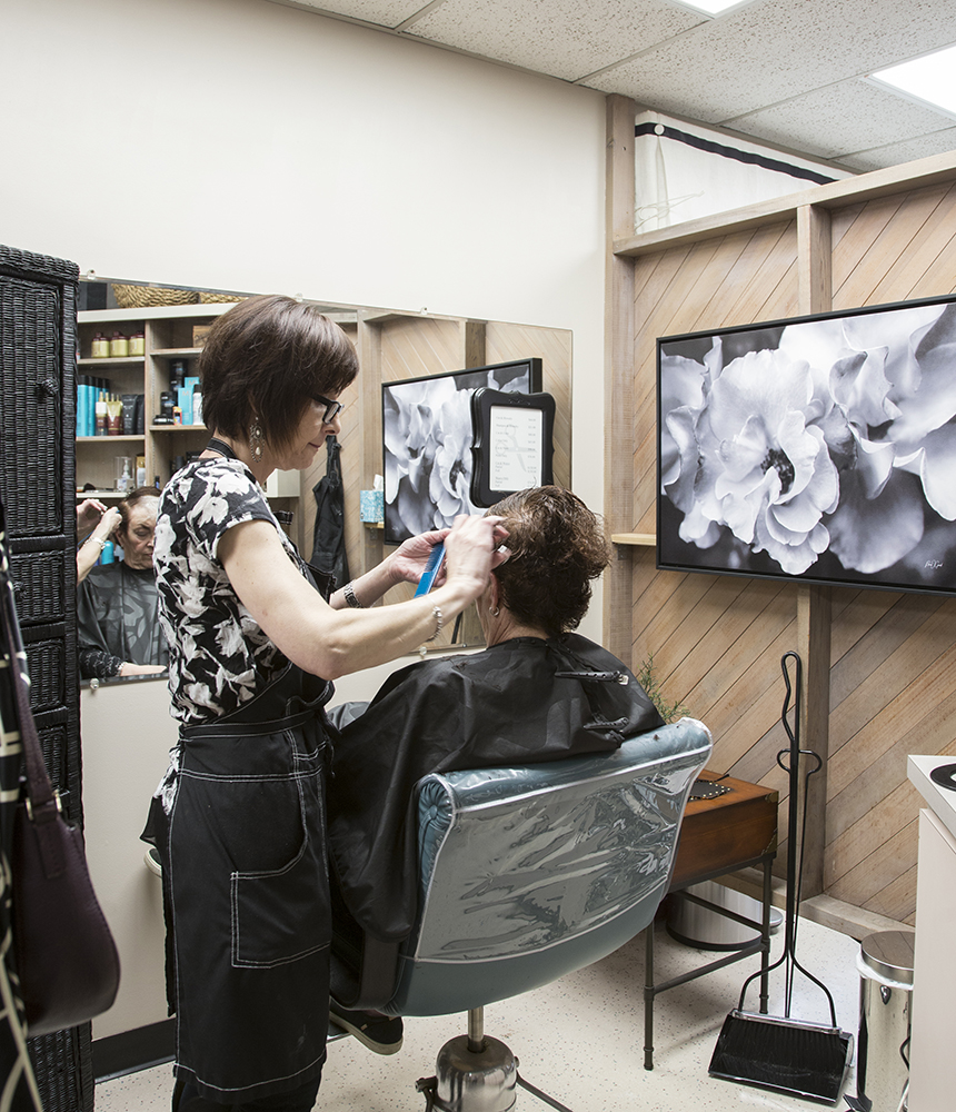 Beth Koblegarde cuts the hair of Carol Sutton at Shears Ahead salon, Tigard, Oregon, April 15, 2019.