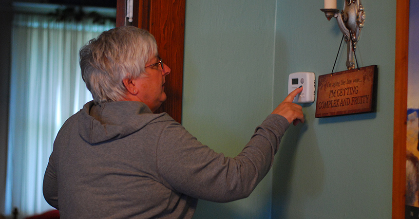 Homeowner with thermostat