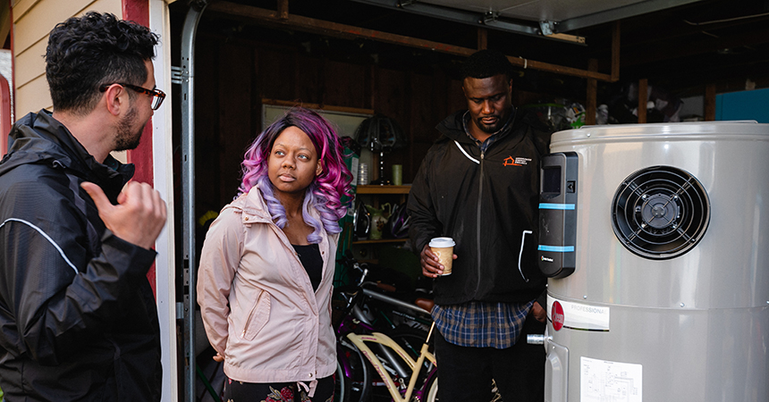 3 people talking near a water heater